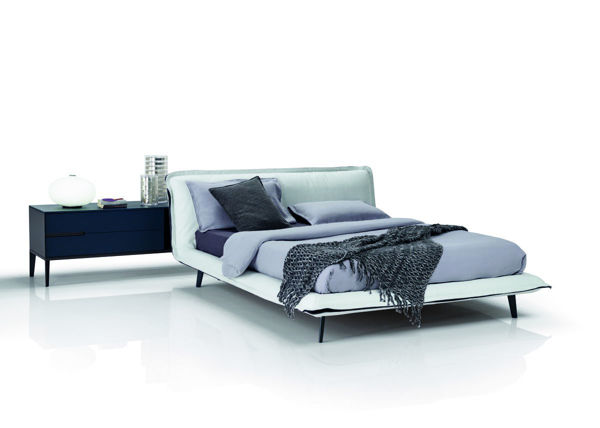 Picture of Natuzzi Italia Piuma queen bed frame in warm white leather with grey fabric ruffle.
